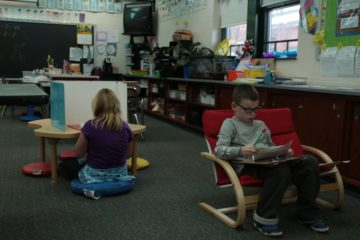 picture First-grade students at Wyland Elementary School complete classroom assignments in the seating of their choice.