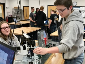 Students building automated assembly lines