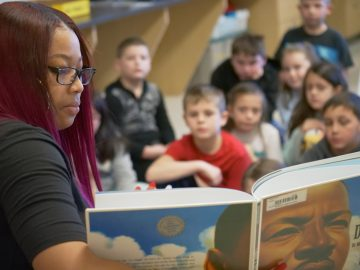 The Centennial Team (Tennent Equity Ambassador Members) read to inspire others